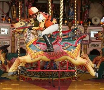 Jockey-Riding-a-Horse-on-a-Carousel--107265